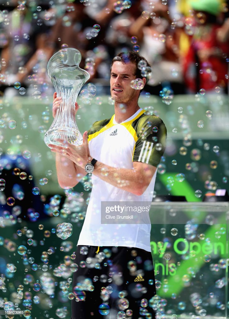 Andy Murray of Great Britain holds aloft the trophy after his three set victory against David Ferrer of Spain during their final match at the Sony Open at Crandon Park Tennis Center on March 31, 2013 in Key Biscayne, Florida.