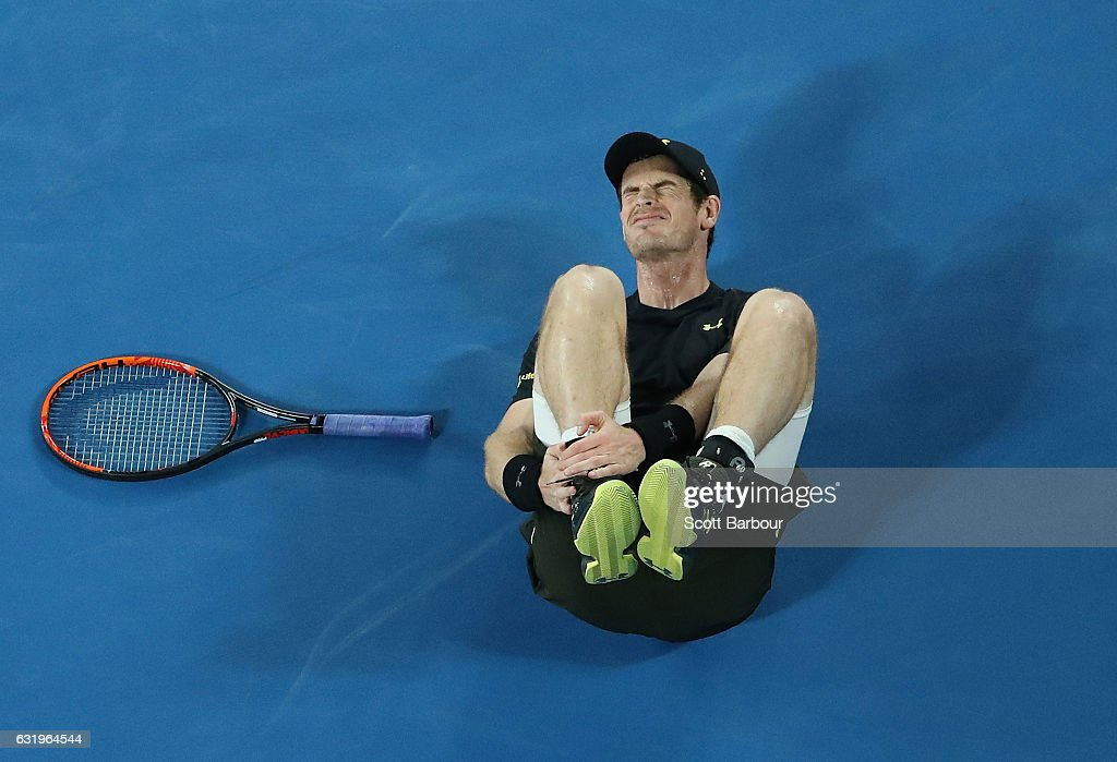 Andy Murray of Great Britain holds his ankle after he fell over in his second round match against Andrey Rublev of Russia on day three of the 2017 Australian Open at Melbourne Park on January 18, 2017 in Melbourne, Australia.