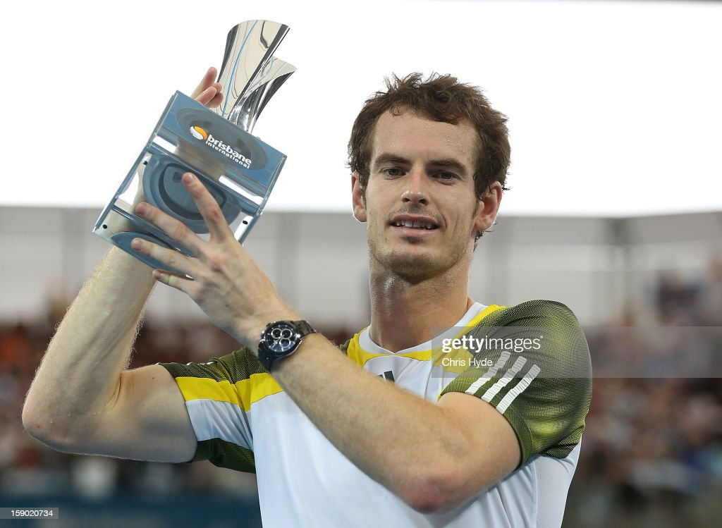 <a gi-track='captionPersonalityLinkClicked' href=/galleries/search?phrase=Andy+Murray+-+Tennis+Player&family=editorial&specificpeople=200668 ng-click='$event.stopPropagation()'>Andy Murray</a> of Great Britain holds the winners trophy after his final match against Grigor Dimitrov of Bulgaria on day eight of the Brisbane International at Pat Rafter Arena on January 6, 2013 in Brisbane, Australia.
