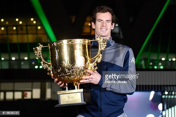 Andy Murray of Great Britain holds the winners trophy after winning the Men's Singles final against Grigor Dimitrov of Bulgaria on day nine of the...