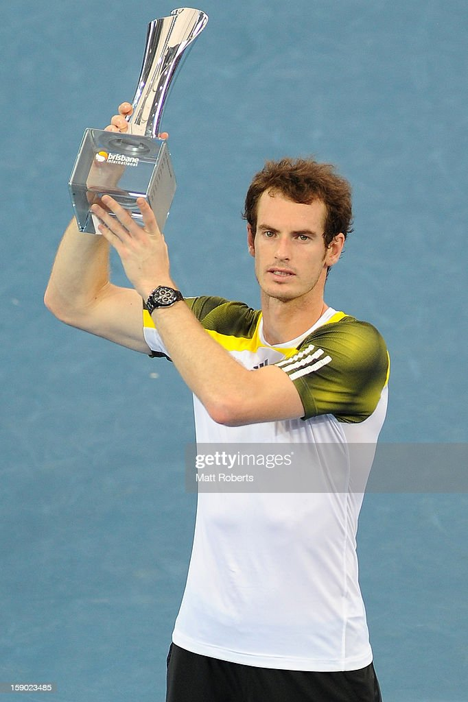 Andy Murray of Great Britain holds the winners trophy aloft after his final match against Grigor Dimitrov of Bulgaria on day eight of the Brisbane International at Pat Rafter Arena on January 6, 2013 in Brisbane, Australia.