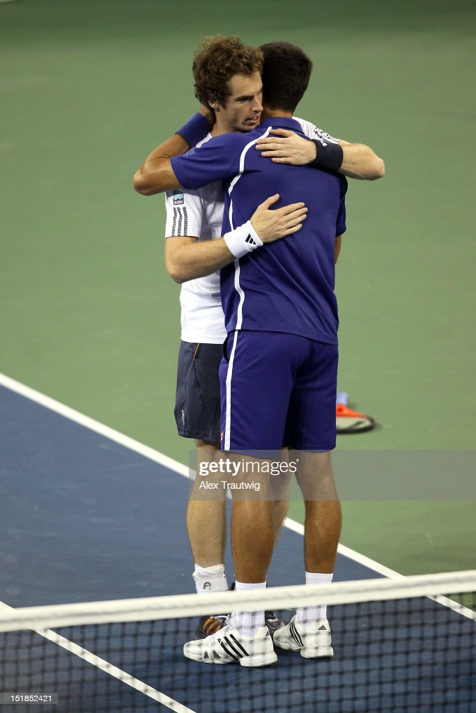 <a gi-track='captionPersonalityLinkClicked' href=/galleries/search?phrase=Andy+Murray+-+Tennisser&family=editorial&specificpeople=200668 ng-click='$event.stopPropagation()'>Andy Murray</a> of Great Britain hugs <a gi-track='captionPersonalityLinkClicked' href=/galleries/search?phrase=Novak+Djokovic&family=editorial&specificpeople=588315 ng-click='$event.stopPropagation()'>Novak Djokovic</a> of Serbia following his victory in the men's singles final match on Day Fifteen of the 2012 US Open at USTA Billie Jean King National Tennis Center on September 10, 2012 in the Flushing neighborhood of the Queens borough of New York City. Murray defeated Djokovic 7-6, 7-5, 2-6, 3-6, 6-2.
