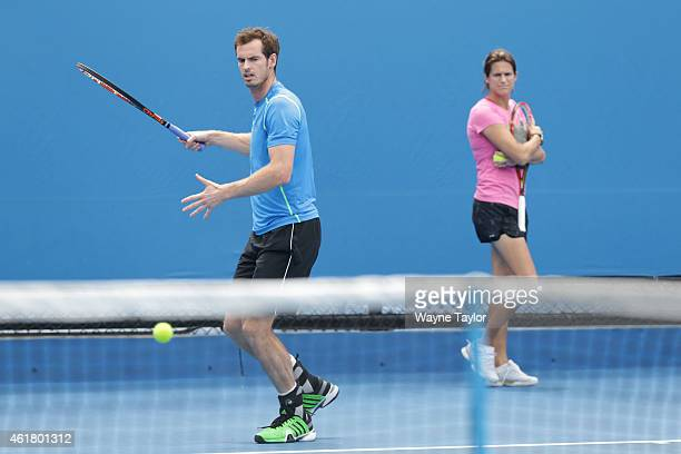 Andy Murray of Great Britain in a practice session as new coach Amelie Mauresmo watches on during day two of the 2015 Australian Open at Melbourne...
