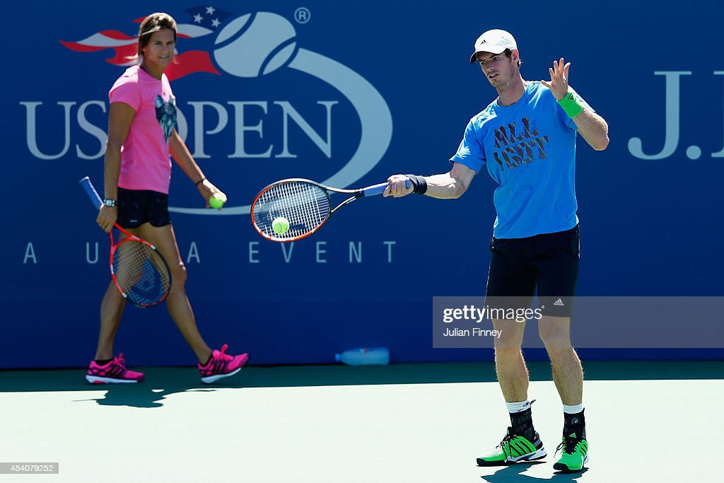 Andy Murray of Great Britain in a practice session watched by coach Amelie Mauresmo during previews for the US Open tennis at USTA Billie Jean King National Tennis Center on August 24, 2014 in New York City.