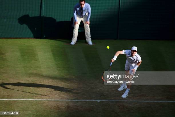 Andy Murray of Great Britain in action against Fabio Fognini of Italy on Centre Court in the Gentlemen's Singles competition during the Wimbledon...