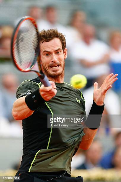 Andy Murray of Great Britain in action against Rafael Nadal of Spain in the final during day nine of the Mutua Madrid Open tennis tournament at the...