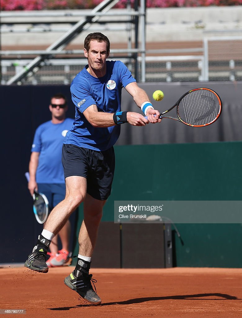 Andy Murray of Great Britain in action during a practice session watched by a Great Britain captain <a gi-track='captionPersonalityLinkClicked' href=/galleries/search?phrase=Leon+Smith+-+Tennis+Coach&family=editorial&specificpeople=12698515 ng-click='$event.stopPropagation()'>Leon Smith</a> prior to the Davis Cup World Group first round between the U.S. and Great Britain at PETCO Park on January 29, 2014 in San Diego, California.