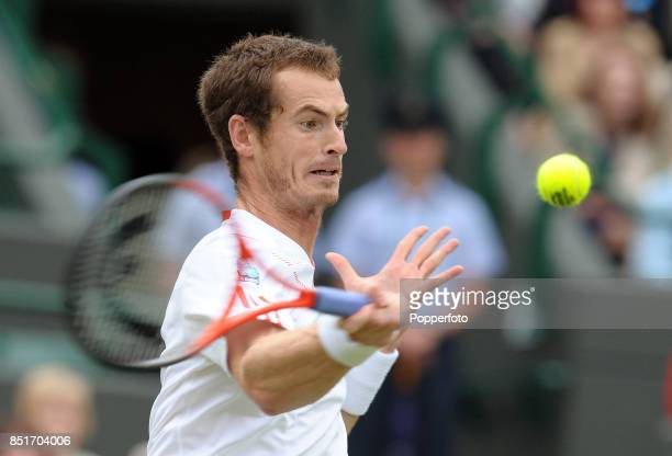 Andy Murray of Great Britain in action during his Gentlemen's Singles fourth round match against Marin Cilic of Croatia on Day Seven of the Wimbledon...