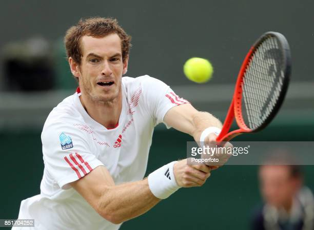 Andy Murray of Great Britain in action during his Gentlemen's Singles fourth round match against Marin Cilic of Croatia on Day Eight of the Wimbledon...
