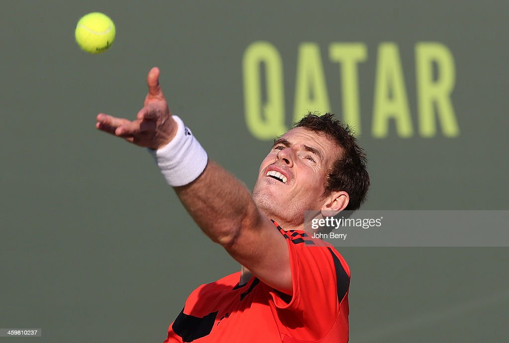 Andy Murray of Great Britain in action in his first round match against wildcard Mousa Zayed of Qatar during the Qatar ExxonMobil Open 2014 held at...