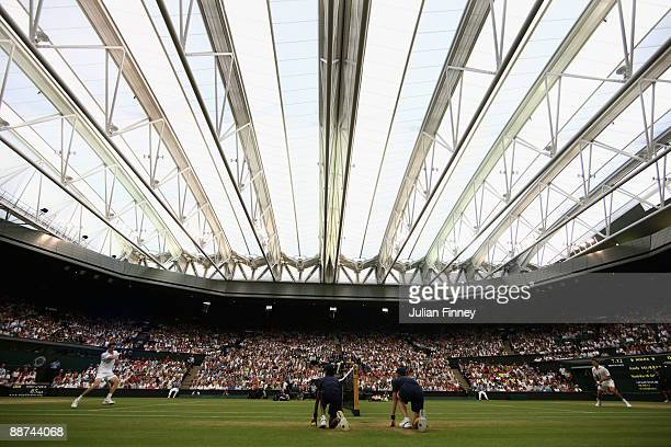 Andy Murray of Great Britain in action under the new Centre Court roof during the men's singles fourth round match against Stanislas Wawrinka of...