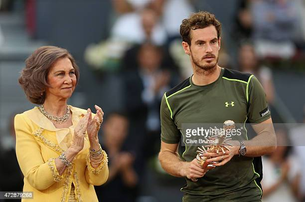 Andy Murray of Great Britain is applauded by Queen Sofia of Spain as he poses with his winners trophy after his straight sets victory against Rafael...