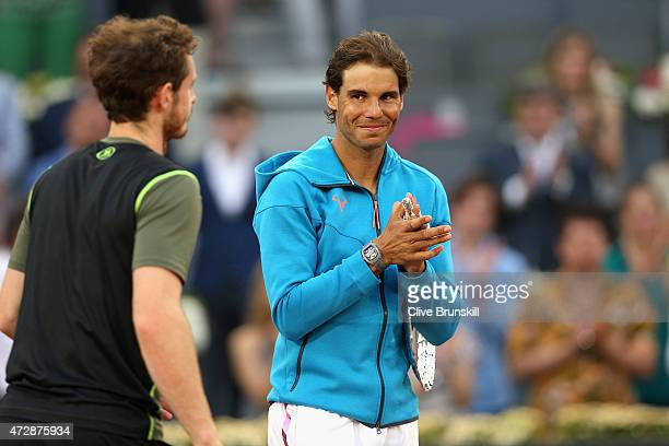 Andy Murray of Great Britain is applauded by Rafael Nadal of Spain after his straight sets victory in the mens final during day nine of the Mutua...