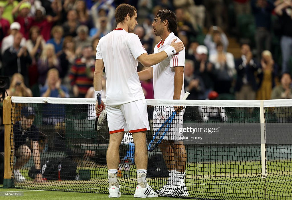 Andy Murray of Great Britain is congratulated by Marcos Baghdatis of Cyprus after his Gentlemen's Singles third round match on day six of the Wimbledon Lawn Tennis Championships at the All England Lawn Tennis and Croquet Club at Wimbledon on June 30, 2012 in London, England.