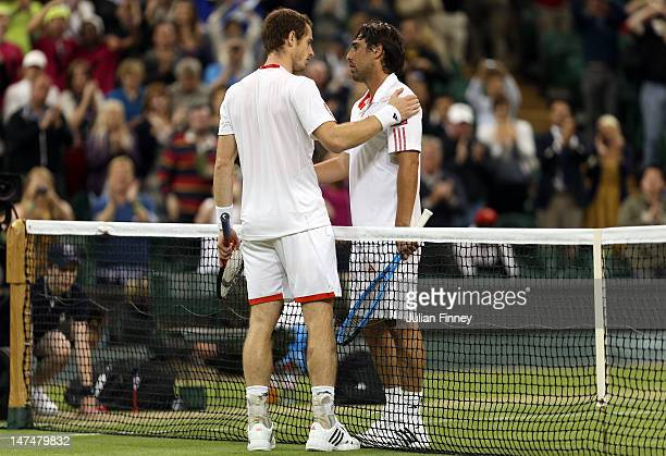 Andy Murray of Great Britain is congratulated by Marcos Baghdatis of Cyprus after his Gentlemen's Singles third round match on day six of the...