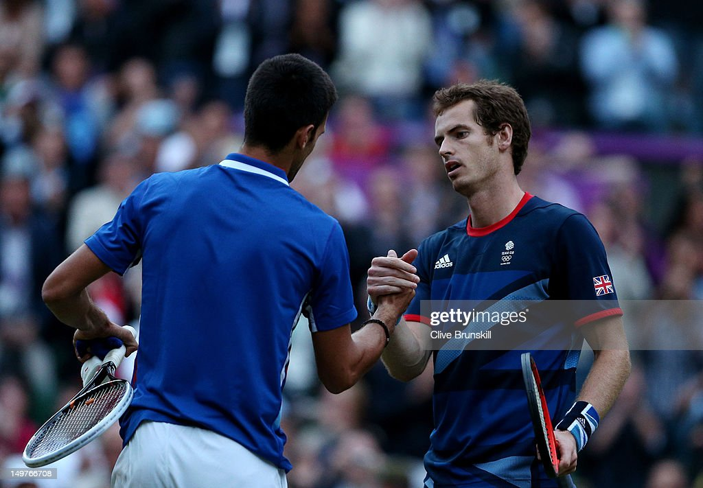 <a gi-track='captionPersonalityLinkClicked' href=/galleries/search?phrase=Andy+Murray+-+Tennis+Player&family=editorial&specificpeople=200668 ng-click='$event.stopPropagation()'>Andy Murray</a> (R) of Great Britain is congratulated by <a gi-track='captionPersonalityLinkClicked' href=/galleries/search?phrase=Novak+Djokovic&family=editorial&specificpeople=588315 ng-click='$event.stopPropagation()'>Novak Djokovic</a> (L) of Serbia after his 7-5, 7-5 win in the Semifinal of Men's Singles Tennis on Day 7 of the London 2012 Olympic Games at Wimbledon on August 3, 2012 in London, England.