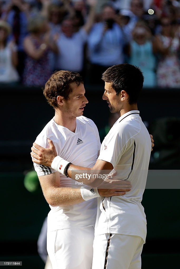 Andy Murray of Great Britain is congratulated by <a gi-track='captionPersonalityLinkClicked' href=/galleries/search?phrase=Novak+Djokovic&family=editorial&specificpeople=588315 ng-click='$event.stopPropagation()'>Novak Djokovic</a> of Serbia following his victory in the Gentlemen's Singles Final match against <a gi-track='captionPersonalityLinkClicked' href=/galleries/search?phrase=Novak+Djokovic&family=editorial&specificpeople=588315 ng-click='$event.stopPropagation()'>Novak Djokovic</a> of Serbia on day thirteen of the Wimbledon Lawn Tennis Championships at the All England Lawn Tennis and Croquet Club on July 7, 2013 in London, England.