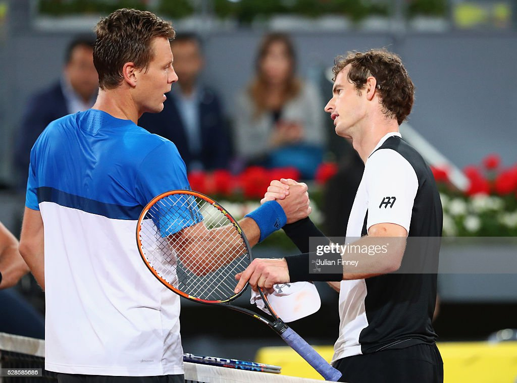 <a gi-track='captionPersonalityLinkClicked' href=/galleries/search?phrase=Andy+Murray+-+Tennis+Player&family=editorial&specificpeople=200668 ng-click='$event.stopPropagation()'>Andy Murray</a> of Great Britain is congratulated by <a gi-track='captionPersonalityLinkClicked' href=/galleries/search?phrase=Tomas+Berdych&family=editorial&specificpeople=239147 ng-click='$event.stopPropagation()'>Tomas Berdych</a> of Czech Republic after his straight sets win during day seven of the Mutua Madrid Open tennis tournament at the Caja Magica on May 06, 2016 in Madrid, Spain.