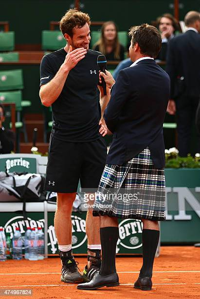 Andy Murray of Great Britain is interviewed by Fabrice Santoro after victory his Men's Singles match against Joao Sousa of Portugal on day five of...