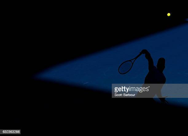 Andy Murray of Great Britain is silhouetted as he serves in his fourth round match against Mischa Zverev of Germany on day seven of the 2017...