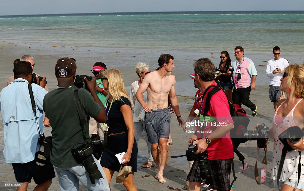 Andy Murray of Great Britain is surrounded by the media after a swim in the ocean after his three set victory against David Ferrer of Spain during their final match at the Sony Open at Crandon Park Tennis Center on March 31, 2013 in Key Biscayne, Florida.