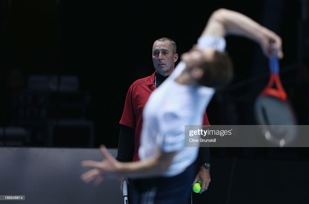 Andy Murray of Great Britain is watched by his coach Ivan Lendl as he serves during a practice session prior to the start of ATP World Tour Finals Tennis at the O2 Arena on November 3, 2012 in London, England.