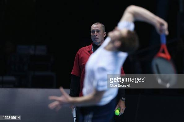 Andy Murray of Great Britain is watched by his coach Ivan Lendl as he serves during a practice session prior to the start of ATP World Tour Finals...