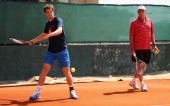 Andy Murray of Great Britain is watched by his coach Ivan Lendl at a practice session prior to his second round match during day three of the ATP...