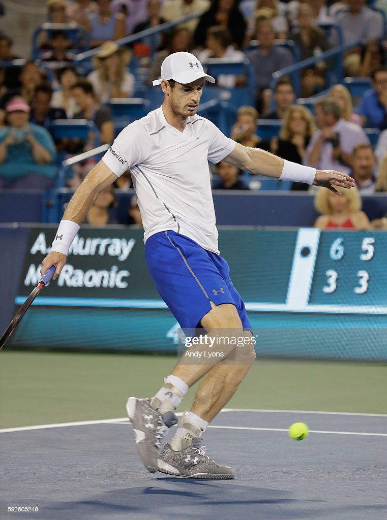 Andy Murray of Great Britain kicks a tennis ball in the semifinal match against Milos Raonic during day 8 of the Western & Southern Open at the Lindner Family Tennis Center on August 20, 2016 in Mason, Ohio.