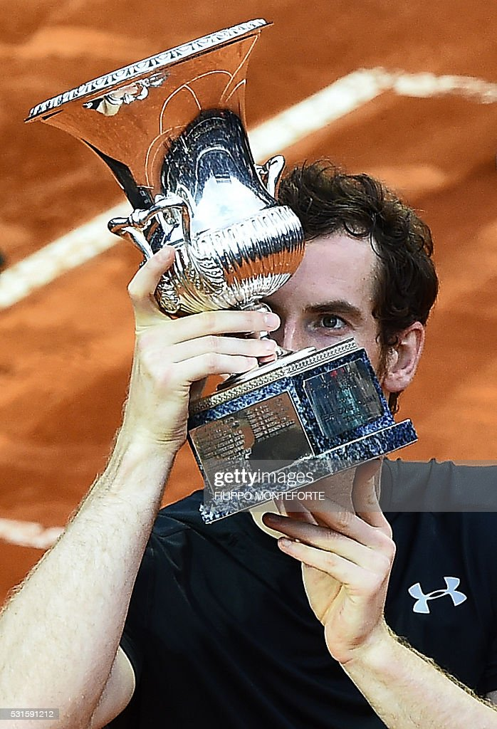 Andy Murray of Great Britain kisses the trophy after beating Serbia's Novak Djokovic in the final match of the ATP Tennis Open tournament game at the Foro Italico in Rome on May 15, 2016. / AFP / FILIPPO