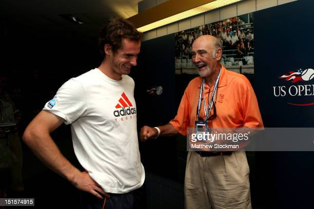 Andy Murray of Great Britain laughs with actor Sean Connery after his men's singles semifinal match against Tomas Berdych of Czech Republic on Day...