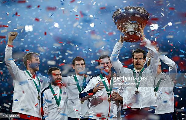 Andy Murray of Great Britain lifts the trophy following his team's victory during day three of the Davis Cup Final match between Belgium and Great...