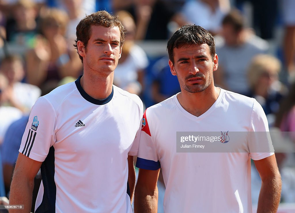 Andy Murray of Great Britain lines up next to Ivan Dodig of Croatia before their match during day three of the Davis Cup World Group play-off tie between Croatia and Great Britain at Stadion Stella Maris on September 15, 2013 in Umag, Croatia.