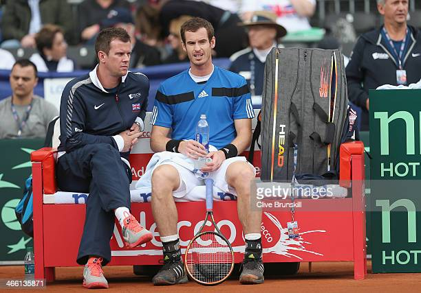 Andy Murray of Great Britain listens to his captain Leon Smith during his match against Donald Young of the United States during day one of the Davis...