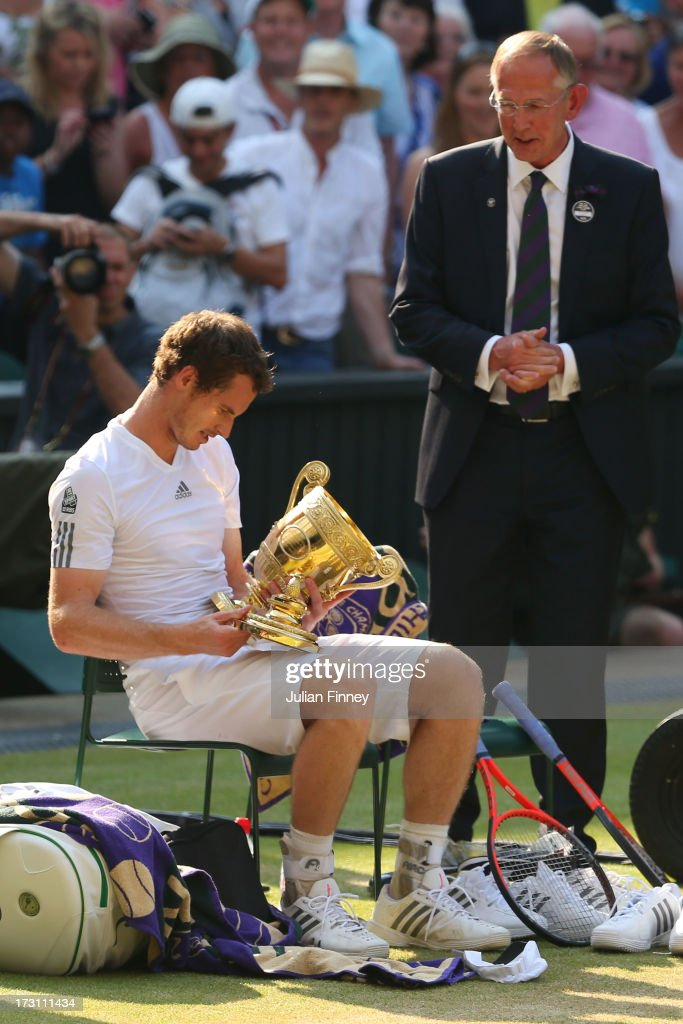 Andy Murray of Great Britain looks at the Gentlemen's Singles Trophy following his victory in the Gentlemen's Singles Final match against Novak Djokovic of Serbia on day thirteen of the Wimbledon Lawn Tennis Championships at the All England Lawn Tennis and Croquet Club on July 7, 2013 in London, England.