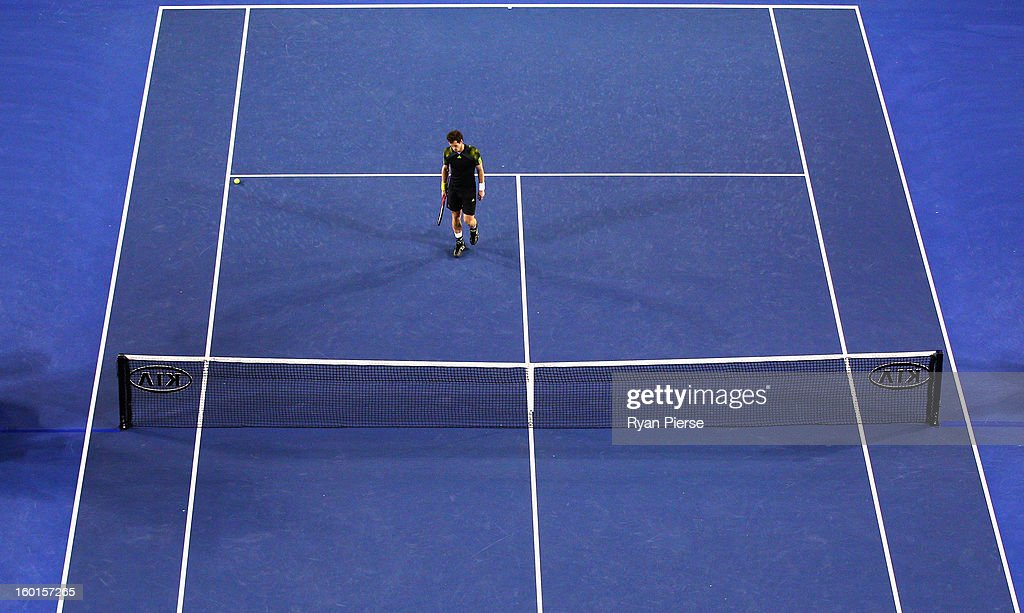 Andy Murray of Great Britain looks dejected after losing championship point in his men's final match against Novak Djokovic of Serbia during day fourteen of the 2013 Australian Open at Melbourne Park on January 27, 2013 in Melbourne, Australia.