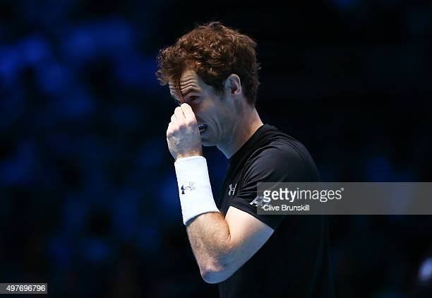 Andy Murray of Great Britain looks frustrated with his hair in his men's singles match against Rafael Nadal of Spain during day four of the Barclays...