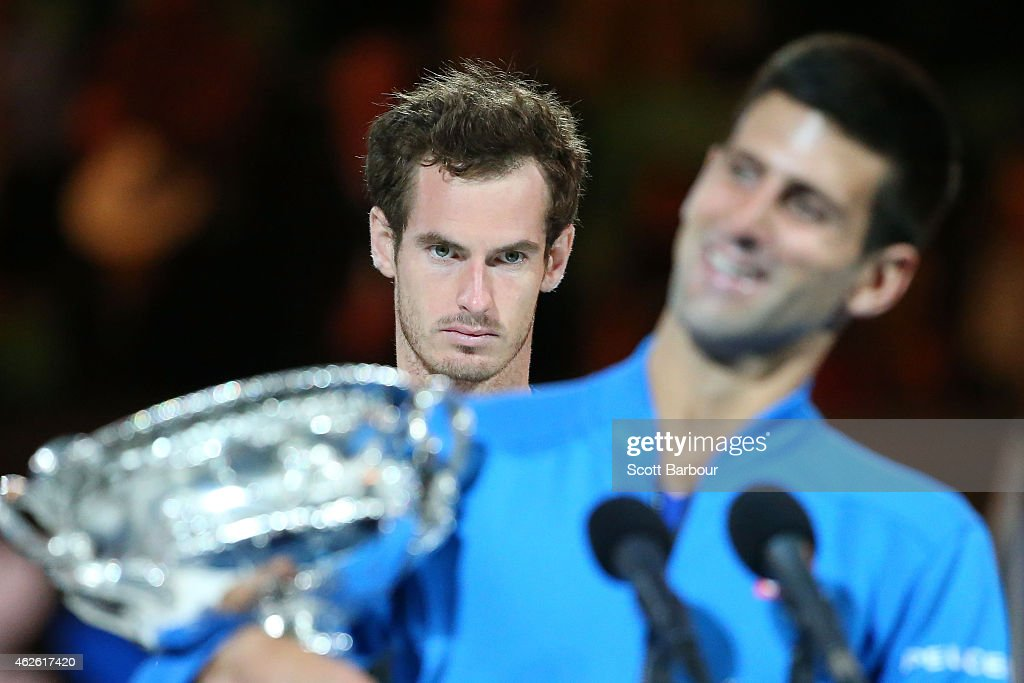 Andy Murray of Great Britain looks on as Novak Djokovic of Serbia holds the Norman Brookes Challenge Cup after he won their men's final match during day 14 of the 2015 Australian Open at Melbourne Park on February 1, 2015 in Melbourne, Australia.