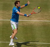 Andy Murray of Great Britain makes a backhand return during his Men's Singles semi final match against Andy Roddick of the United States on day six...