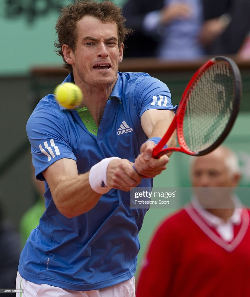 Andy Murray of Great Britain makes a backhand return during the men's singles round three match between Andy Murray of Great Britain and Michael...