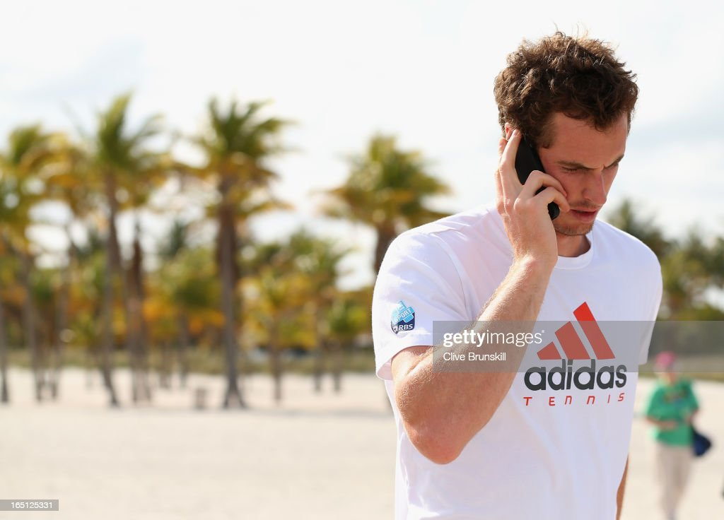 Andy Murray of Great Britain makes a phone call on the beach after his three set victory against David Ferrer of Spain during their final match at the Sony Open at Crandon Park Tennis Center on March 31, 2013 in Key Biscayne, Florida.