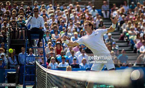 Andy Murray of Great Britain partnering Dominic Inglot of Great Britain hits a volley at the net in the men's doubles first round match against...