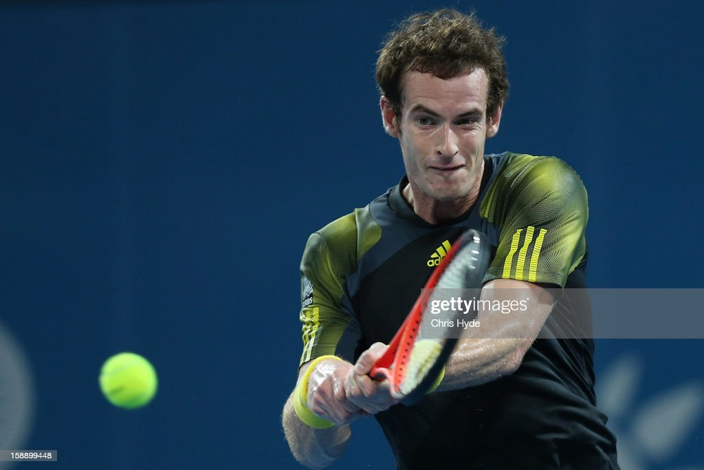 <a gi-track='captionPersonalityLinkClicked' href=/galleries/search?phrase=Andy+Murray+-+Tennis+Player&family=editorial&specificpeople=200668 ng-click='$event.stopPropagation()'>Andy Murray</a> of Great Britain play a backhand during his match against John Millman of Australia on during day five of the Brisbane International at Pat Rafter Arena on January 3, 2013 in Brisbane, Australia.