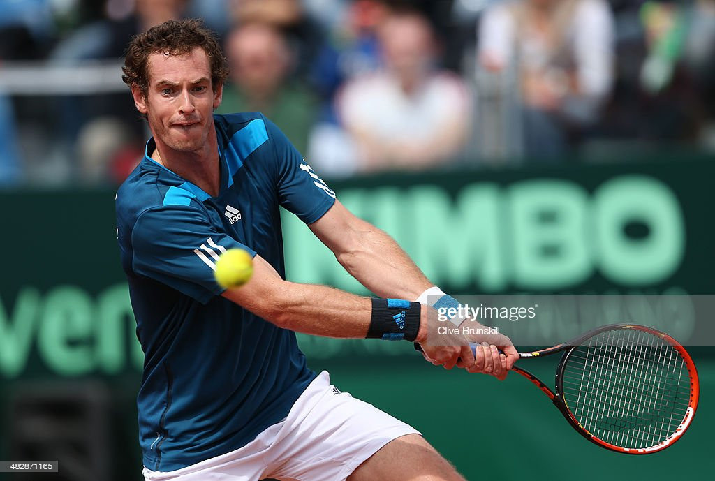 Andy Murray of Great Britain plays a backhand against Andreas Seppi of Italy during day two of the Davis Cup World Group Quarter Final match between Italy and Great Britain at Tennis Club Napoli on April 5, 2014 in Naples, Italy.