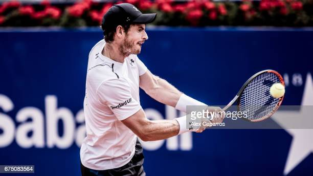 Andy Murray of Great Britain plays a backhand against Dominic Thiem of Austria in their semifinal match on day six of the Barcelona Open Banc...