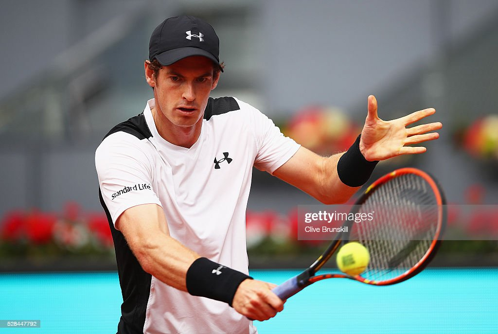 Andy Murray of Great Britain plays a backhand against Gilles Simon of France in their third round match during day six of the Mutua Madrid Open tennis tournament at the Caja Magica on May 05, 2016 in Madrid,Spain