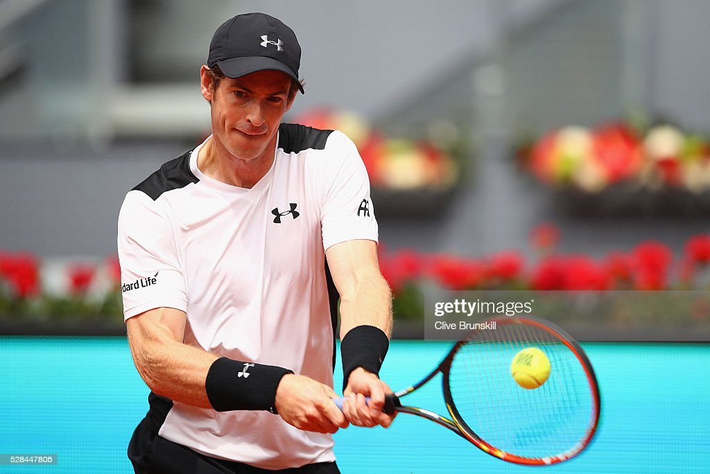 <a gi-track='captionPersonalityLinkClicked' href=/galleries/search?phrase=Andy+Murray+-+Tennisser&family=editorial&specificpeople=200668 ng-click='$event.stopPropagation()'>Andy Murray</a> of Great Britain plays a backhand against Gilles Simon of France in their third round match during day six of the Mutua Madrid Open tennis tournament at the Caja Magica on May 05, 2016 in Madrid,Spain