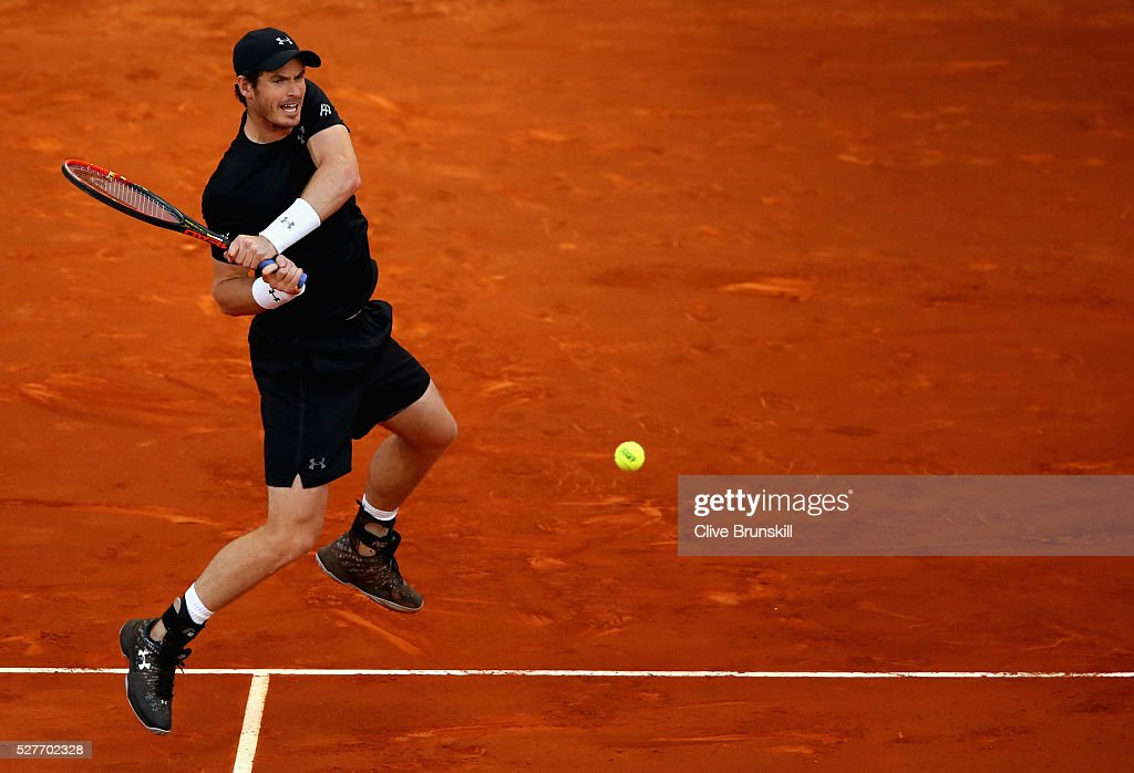 <a gi-track='captionPersonalityLinkClicked' href=/galleries/search?phrase=Andy+Murray+-+Tennis+Player&family=editorial&specificpeople=200668 ng-click='$event.stopPropagation()'>Andy Murray</a> of Great Britain plays a backhand against Radek Stepanek of the Czech Republic in their second round match during day four of the Mutua Madrid Open tennis tournament at the Caja Magica on May 03, 2016 in Madrid,Spain.