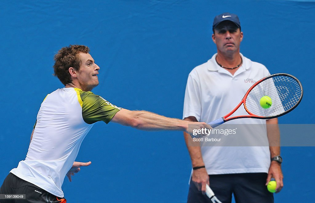 Andy Murray of Great Britain plays a backhand as his coach Ivan Lendl watches on during a practice session ahead of the 2013 Australian Open at Melbourne Park on January 9, 2013 in Melbourne, Australia.