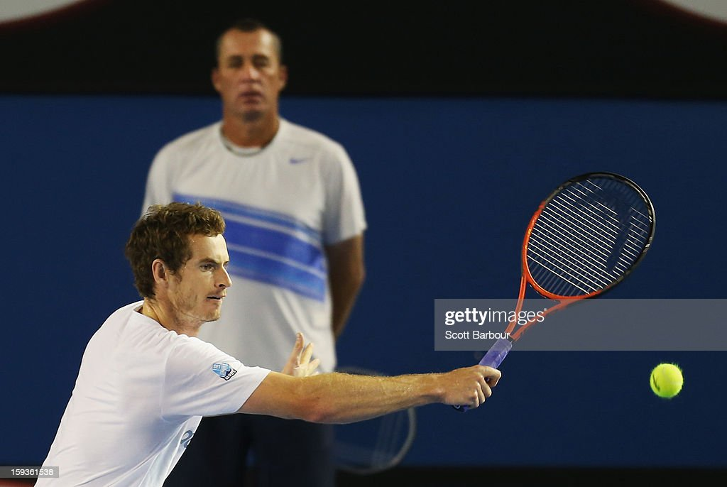 Andy Murray of Great Britain plays a backhand as his coach Ivan Lendl watches on during a practice session ahead of the 2013 Australian Open at Melbourne Park on January 13, 2013 in Melbourne, Australia.
